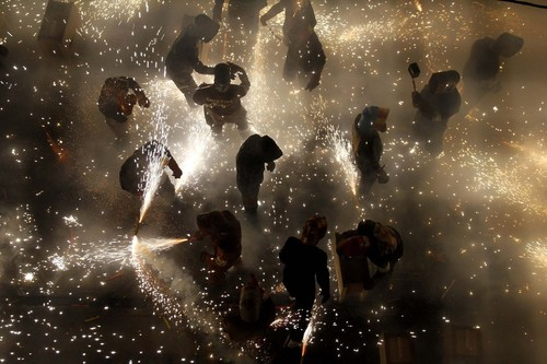 "Revellers play with fireworks in an enclosed area on the main street of the village of Paterna near Valencia during the annual ""Corda"" festivity"
